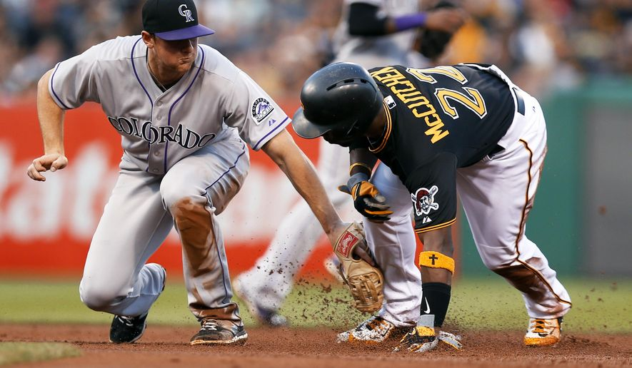 Pittsburgh Pirates' Andrew McCutchen, right, avoids the tag of Colorado Rockies second baseman DJ LeMahieu to steal second during the first inning of a baseball game, Friday, Aug. 28, 2015, in Pittsburgh. (AP Photo/Keith Srakocic)
