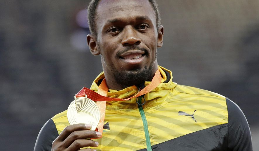 Men's 200m gold medalist Jamaica's Usain Bolt celebrates on the podium at the World Athletics Championships at the Bird's Nest stadium in Beijing, Friday, Aug. 28, 2015. (AP Photo/Kin Cheung)