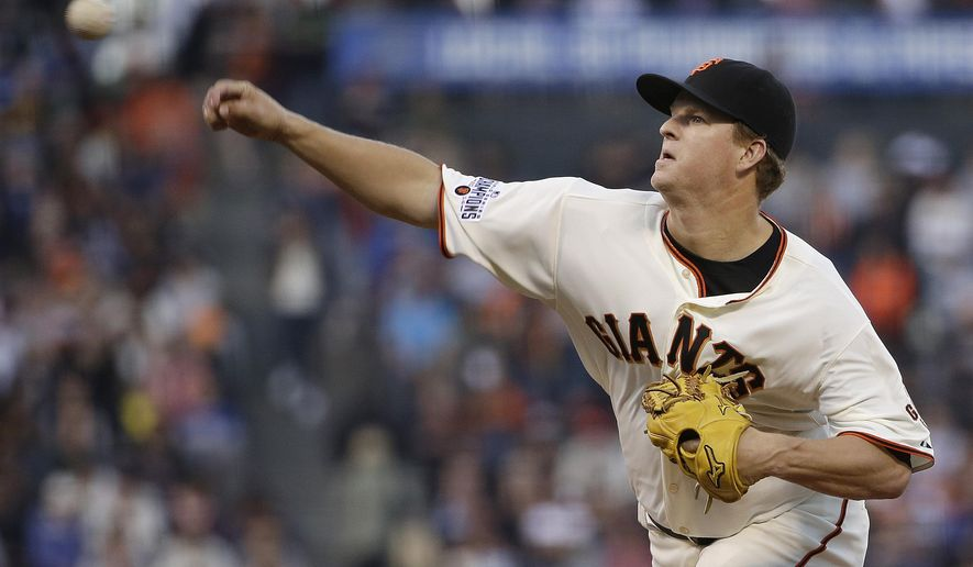 San Francisco Giants pitcher Matt Cain throws against the Chicago Cubs during the second inning of a baseball game in San Francisco, Tuesday, Aug. 25, 2015. (AP Photo/Jeff Chiu)