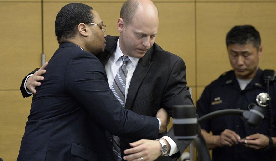 DENVER, CO - AUGUST 27:   Defendant Dexter Lewis embraces defense attorney David Kraut, right, in Denver District Court on Thursday, Aug. 27, 2015. Jurors have spared Lewis the death penalty, and he will instead be sentenced to life in prison. Lewis was convicted Aug. 10 of five counts of murder for stabbing five people to death in a bar robbery in October 2012. (Cyrus McCrimmon/The Denver Post via AP) MAGS OUT; TV OUT; INTERNET OUT; NO SALES; NEW YORK POST OUT; NEW YORK DAILY NEWS OUT; MANDATORY CREDIT