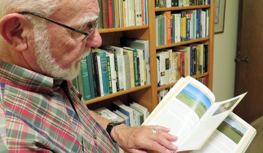 Bob Janssen showed off his new book, ''Birds of Minnesota State Parks,'' at his home in Golden Valley, Minn., on Aug. 17, 2015. The book highlights state parks as a great place to observe the wide variety of birds that nest in the state or pass through on their spring and fall migrations. (Elizabeth Baier/Minnesota Public Radio via AP)