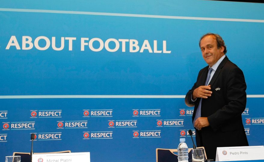 UEFA President Michel Platini arrives at a press conference after the soccer Europa League draw ceremony at the Grimaldi Forum, in Monaco, Friday, Aug. 28, 2015. (AP Photo/Claude Paris)
