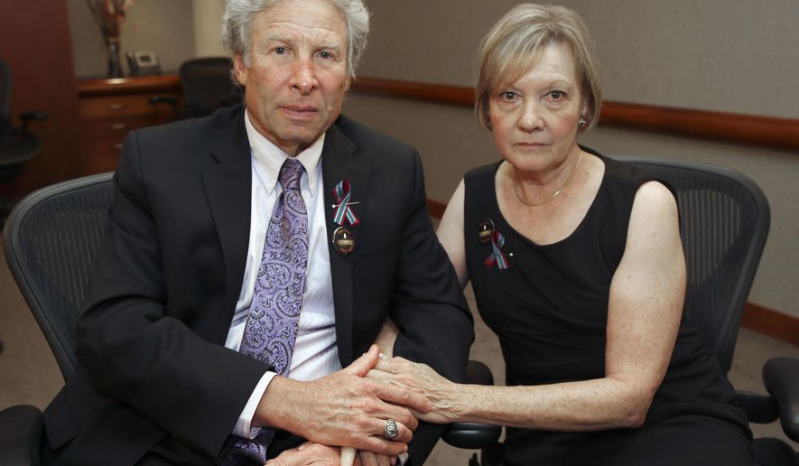 Andy and Barbara Parker, of Collinsville, Va. mourn the loss of their daughter, Alison Parker, a journalist for WDBJ, Friday, Aug. 28, 2015 in Roanoke, Va. Reporter Alison Parker and cameraman Adam Ward were killed by a former colleague during a live broadcast Wednesday, while on assignment in Moneta, Va. (Stephanie Klein-Davis/The Roanoke Times via AP) LOCAL TELEVISION OUT; SALEM TIMES REGISTER OUT; FINCASTLE HERALD OUT;  CHRISTIANBURG NEWS MESSENGER OUT; RADFORD NEWS JOURNAL OUT; ROANOKE STAR SENTINEL OUT; MANDATORY CREDIT MBI