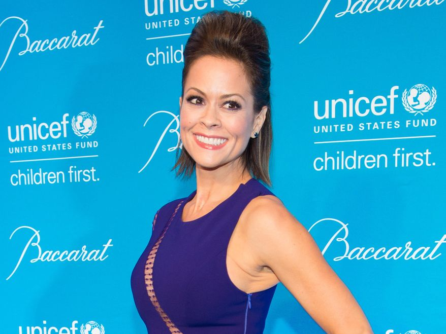 FILE - In this Dec. 2, 2014, file photo, Brooke Burke-Charvet attends the Tenth Annual UNICEF Snowflake Ball in New York. Burke-Charvet, the actress, entrepreneur and fitness guru, will co-host the 2016 Miss America pageant on Sunday, Sept. 13, 2015. She will join co-host Chris Harrison on the nationally televised broadcast from Boardwalk Hall, in Atlantic City, N.J. (Photo by Scott Roth/Invision/AP, File)