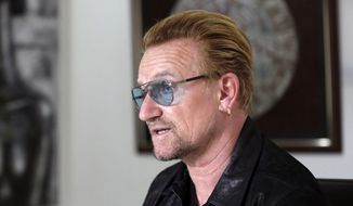 Irish rock star Bono speaks during an interview with the Associated Press in Lagos, Nigeria Friday, Aug. 28, 2015. (AP Photo/Sunday Alamba) ** FILE **