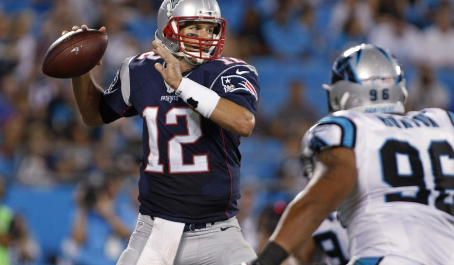 New England Patriots quarterback Tom Brady (12) looks to pass under pressure from Carolina Panthers' Wes Horton (96) during the first half of a preseason NFL football game in Charlotte, N.C., Friday, Aug. 28, 2015. (AP Photo/Bob Leverone)