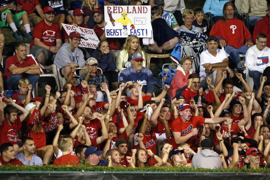 Fans of the Little League team from Lewisberry, Pa., cheer from the hillside overlooking the outfield of Lamade Stadium during a baseball game between Lewisberry and Pearland, Texas, in U.S. play at the Little League World Series tournament in South Williamsport, Pa., Wednesday, Aug. 26, 2015. Lewisberry won 3-0. (AP Photo/Gene J. Puskar)