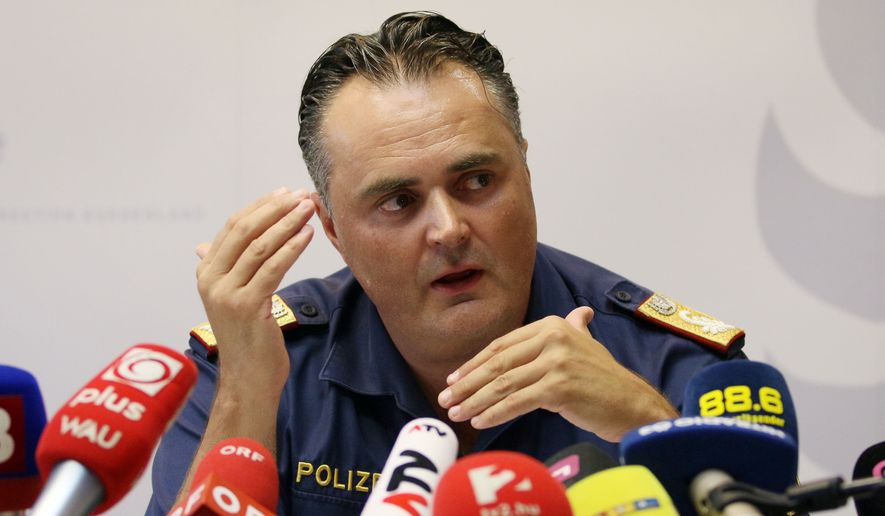 Chief of the Burgenland police, Hans Peter Doskozil, informs the media at a news conference at a police station in Eisenstadt, Austria, Thursday, Aug 27, 2015. Austrian police on Thursday discovered the badly decomposing bodies of at least 20 — and possibly up to 50 — migrants stacked in a truck parked on the shoulder of the main highway from Budapest to Vienna. (AP Photo/Ronald Zak)