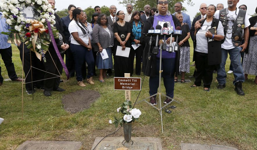 Airickca Gordon Taylor, center, cousin to Emmett Till and Co-Founder of the Mamie Till Mobley Memorial Foundation, addresses the crowd gathered at a gravesite ceremony at the Burr Oak Cemetery marking the 60th anniversary of the murder of Till in Mississippi, Friday, Aug. 28, 2015, in Alsip, Ill. (AP Photo/Charles Rex Arbogast)