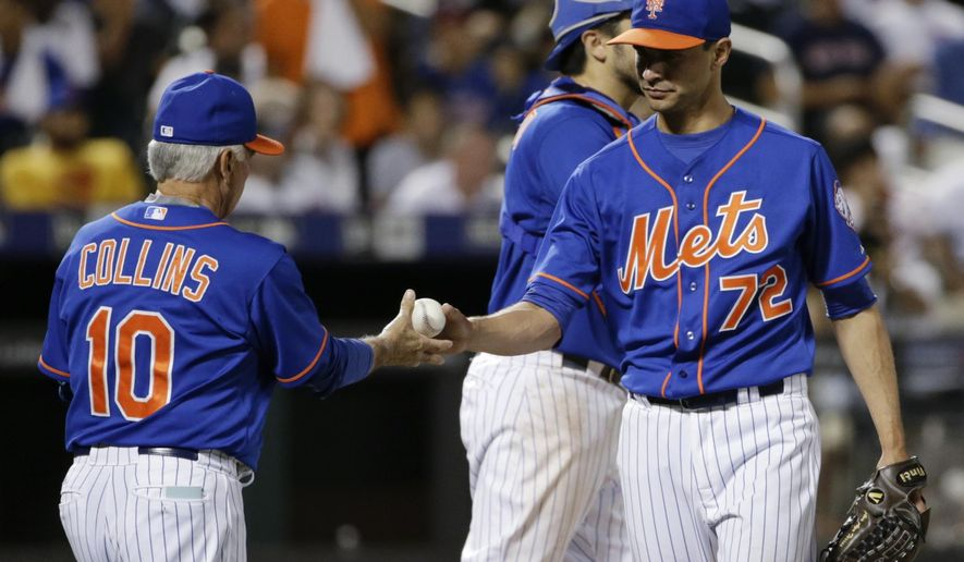 New York Mets manager Terry Collins (10) takes Carlos Torres (72) out of the baseball game during the 10th inning against the Boston Red Sox on Friday, Aug. 28, 2015, in New York. (AP Photo/Frank Franklin II)