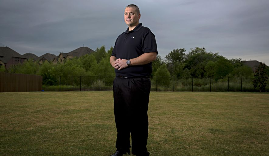 In this Aug. 20, 2015 photo, Shawn Chelf poses outside of his home in Flower Mound, Texas. Chelf was seven years old when his mother, Laurie Bosman, was strangled in her Far North Dallas apartment. The 1987 murder remains unsolved but was recently reopened by detectives in Dallas.  (G.J. McCarthy/The Dallas Morning News) MANDATORY CREDIT; MAGS OUT; TV OUT; INTERNET USE BY AP MEMBERS ONLY; NO SALES