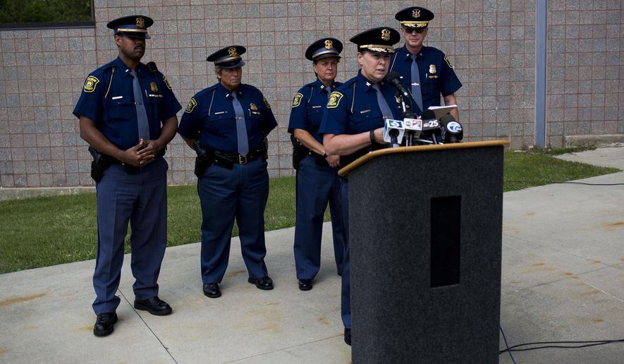 Michigan State Police Director Col. Kriste Kibbey Etue holds a news conference on the status of Trooper Chad Wolf  on Friday, Aug. 28, 2015, at Genesys Regional Medical Center in Grand Blanc Township, Mich.  Wolf  is in critical condition after being knocked from his motorcycle along a Michigan interstate and dragged several miles by a motorist pulling a trailer.  (Danny Miller/The Flint Journal-MLive.com via AP) LOCAL TELEVISION OUT; LOCAL INTERNET OUT; MANDATORY CREDIT