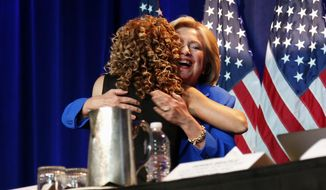 Critics say the superdelegate system, embraced by Democratic National Committee Chairwoman Debbie Wasserman Schultz (left), went a long way to help Hillary Clinton secure enough delegates to win the party's presidential nomination. (Associated Press/File)