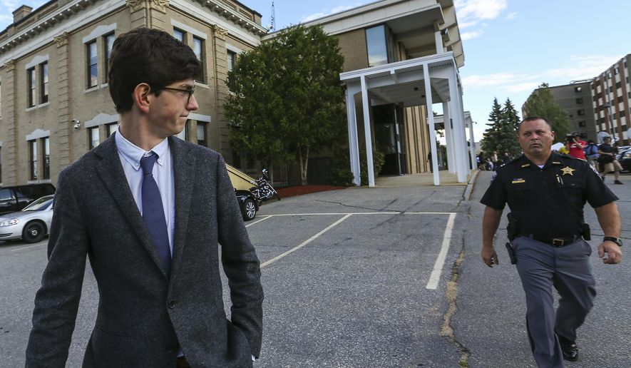 Former St. Paul's School student Owen Labrie, left, leaves the Merrimack Superior Court at the end of day with security in tow while the jury deliberates on Thursday, Aug. 27, 2015, in Concord, N.H. (AP Photo/Cheryl Senter, Pool) ** FILE **