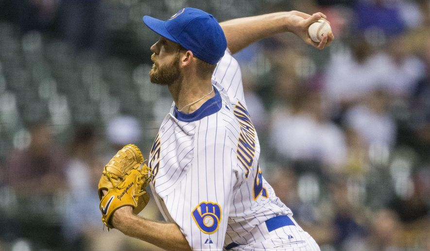 Milwaukee Brewers' Taylor Jungmann pitches to a Cincinnati Reds batter during the first inning of a baseball game Friday, Aug. 28, 2015, in Milwaukee. (AP Photo/Tom Lynn)