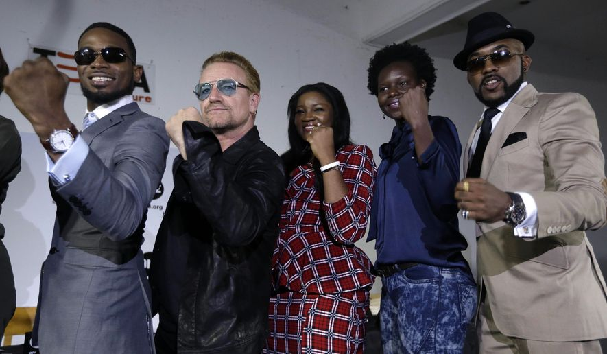 "Irish rock star Bono, second left, poses with African music stars after a press conference in Lagos, Nigeria, Friday, Aug. 28, 2015, African stars and rock star Bono say music can help push for the empowerment of women globally. Bono and the top African male musicians D'banj, Diamond and Banky W announced Friday that they will be included in a remix of the song ""Strong Girl"" - a rallying cry for women's empowerment which features top African female talent. (AP Photo/Sunday Alamba)"