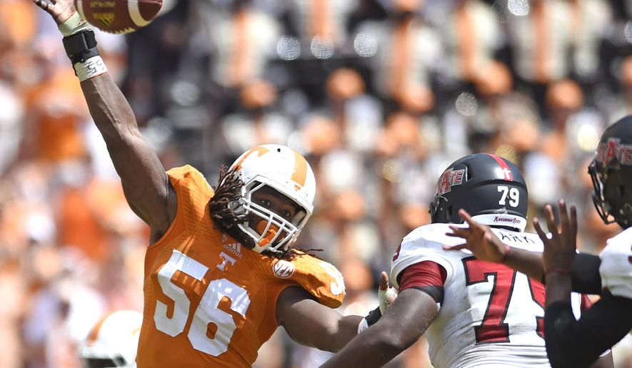 In this Sept. 6, 2014, photo, Tennessee linebacker Curt Maggitt tips a pass during an NCAA football game against Arkansas State in Knoxville, Tenn. Derek Barnett aned Curt Maggitt make No. 25 Tennessee the only Football Bowl Subdivision program to return two players who posted double-digit sack totals last season.  (Adam Lau/Knoxville News Sentinel via AP)
