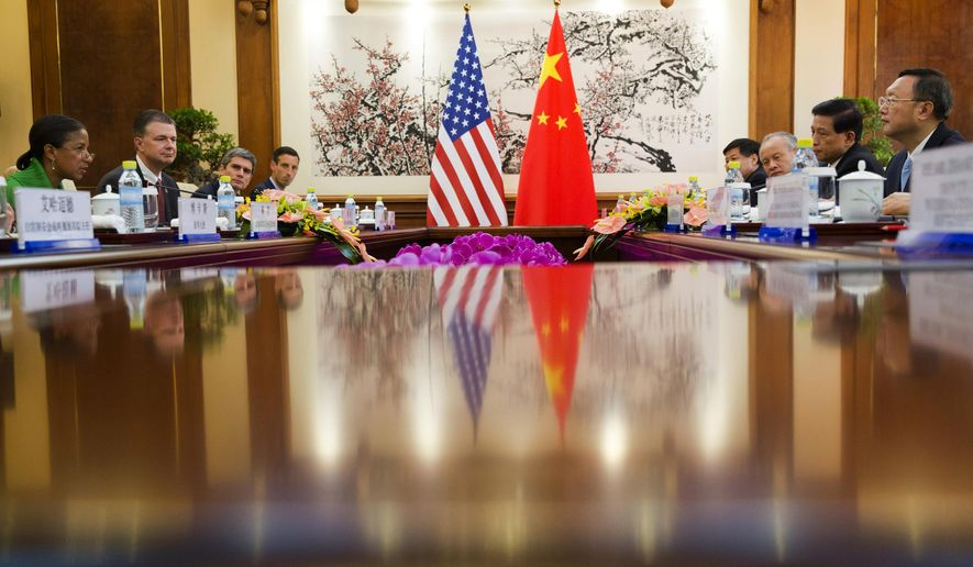 U.S. National Security Advisor Susan Rice, left, takes part in talks with Chinese State Councilor Yang Jiechi, right, at the Diaoyutai State Guesthouse in Beijing Friday, Aug. 28, 2015. (AP Photo/Ng Han Guan, Pool)