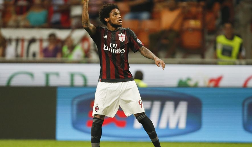 AC Milan's Luiz Adriano celebrates after scoring during a Serie A soccer match between AC Milan and Empoli, at the San Siro stadium in Milan, Italy, Saturday, Aug. 29, 2015. (AP Photo/Luca Bruno)