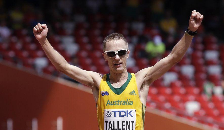 Australia's Jared Tallent celebrates finishing second in the men's 50k race walk final at the World Athletics Championships at the Bird's Nest stadium in Beijing, Saturday, Aug. 29, 2015. (AP Photo/David J. Phillip)