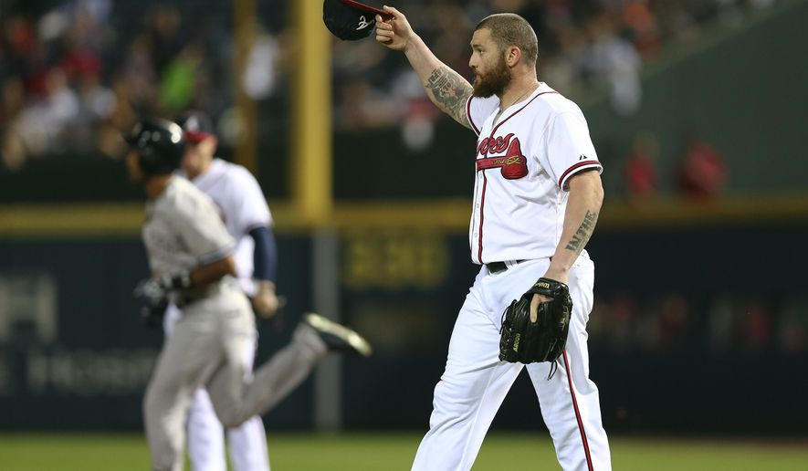 Atlanta Braves outfielder Jonny Gomes, who was pitching in relief, tips his cap as New York Yankees' Chris Young rounds the bases after a solo home run in the ninth inning of a baseball game Friday, Aug. 28, 2015, in Atlanta. (AP Photo/John Bazemore)