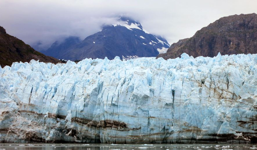 This July 30, 2014 photo shows Margerie Glacier, one of many glaciers that make up Alaska's Glacier Bay National Park. With melting glaciers and rising seas as his backdrop, President Barack Obama will visit Alaska next week to press for urgent global action to combat climate change, even as he carefully calibrates his message in a state heavily dependent on oil.   (AP Photo/Kathy Matheson)