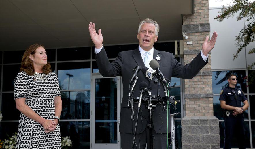 Virginia Gov. Terry McAuliffe, right, speaks to the media next to his wife, Dorothy. (Stephanie Klein-Davis/The Roanoke Times via AP)