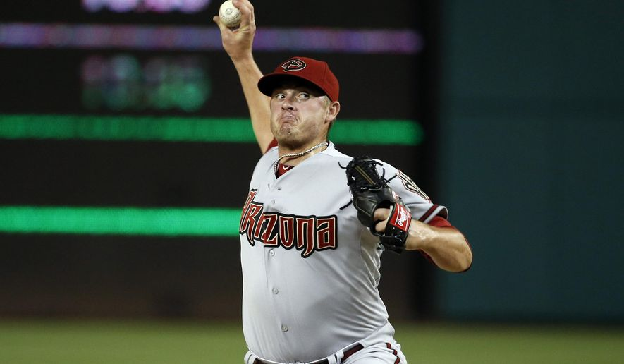 FILE - In this Monday, Aug. 3, 2015 file photo, Arizona Diamondbacks relief pitcher Addison Reed (43) throws during a baseball game against the Washington Nationals at Nationals Park in Washington. A person familiar with the deal says the New York Mets and Arizona Diamondbacks have agreed to a trade that would send reliever Addison Reed to the NL East leaders, Saturday, Aug. 29, 2015.  (AP Photo/Alex Brandon)