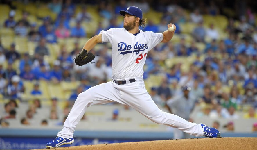 Los Angeles Dodgers starting pitcher Clayton Kershaw throws to the plate during the first inning of a baseball game against the Chicago Cubs, Friday, Aug. 28, 2015, in Los Angeles. (AP Photo/Mark J. Terrill)