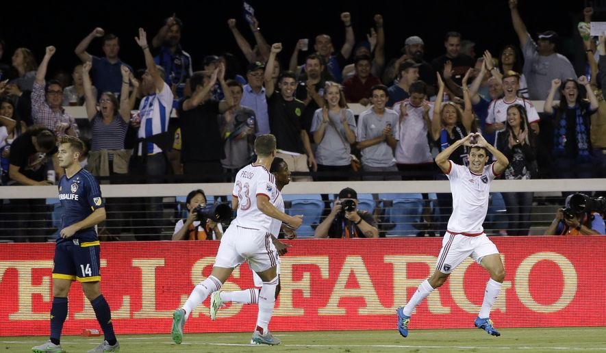 San Jose Earthquakes midfielder Shea Salinas, right, celebrates after scoring against the Los Angeles Galaxy during the first half of an MLS soccer match Friday, Aug. 28, 2015, in San Jose, Calif. (AP Photo/Marcio Jose Sanchez)