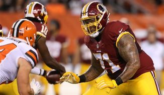 Washington Redskins left tackle Trent Williams signed a five-year extension on Saturday/ AP photo