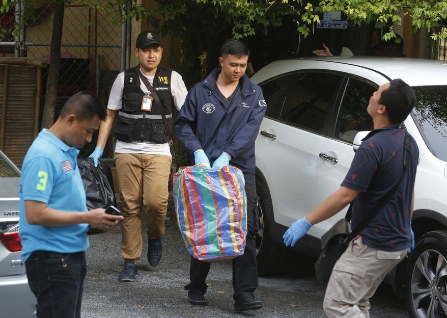 Thai policemen take evidence at an apartment on the outskirts of Bangkok, Thailand on Saturday, Aug. 29, 2015. Thai authorities raided an apartment in suburban Bangkok and arrested a foreigner with a fake Turkish passport and bomb-making materials Saturday, the first possible breakthrough in the deadly bombing at a Bangkok shrine nearly two weeks ago. (AP Photo/Sakchi Lalit)