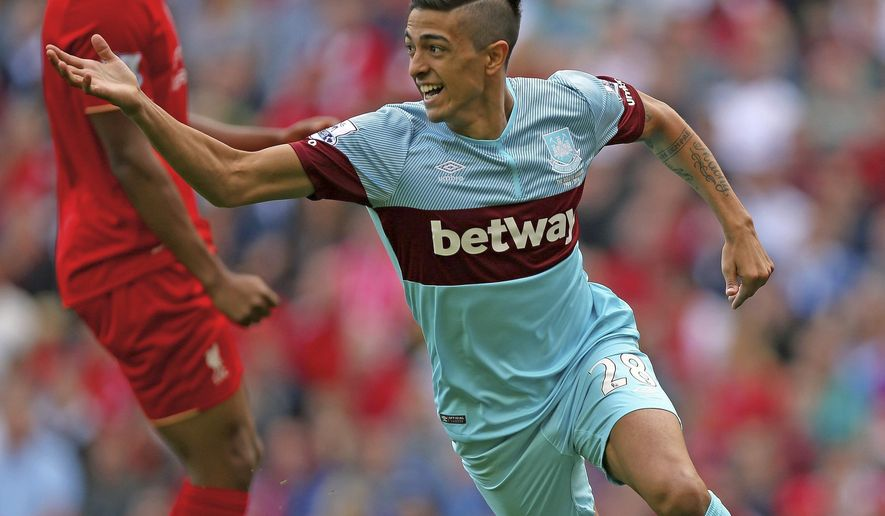 West Ham United's Manuel Lanzini celebrates scoring the first goal of the match during the English Premier League soccer match against Liverpool  at Anfield, Liverpool, England Saturday Aug. 29, 2015. (Peter Byrne/PA via AP) UNITED KINGDOM OUT