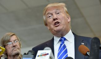Republican presidential candidate Donald Trump answers questions from the media after speaking at a rally at the TD Convention Center, Thursday, Aug. 27, 2015, in Greenville, S.C. (AP Photo/Richard Shiro) ** FILE **