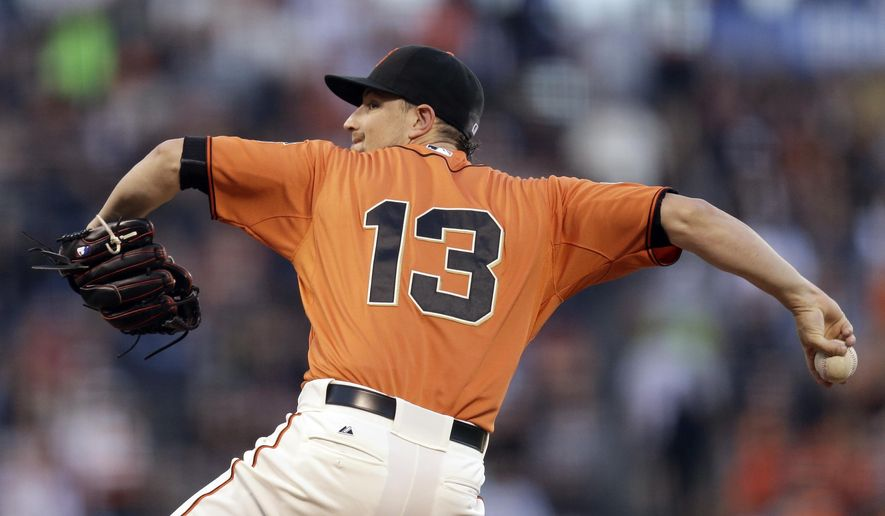 San Francisco Giants pitcher Mike Leake works against the St. Louis Cardinals during the first inning of a baseball game Friday, Aug. 28, 2015, in San Francisco. (AP Photo/Ben Margot)