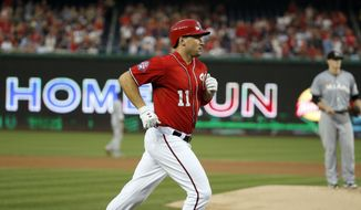 Washington Nationals' Ryan Zimmerman rounds the bases on a solo home run off Miami Marlins starting pitcher Tom Koehler, right, during the second inning of a baseball game at Nationals Park, Saturday, Aug. 29, 2015, in Washington. (AP Photo/Alex Brandon)