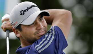 Jason Day, of Australia, hits a tee shot on the 10th hole during the final round of play at The Barclays golf tournament Sunday, Aug. 30, 2015, in Edison, N.J. (AP Photo/Mel Evans)