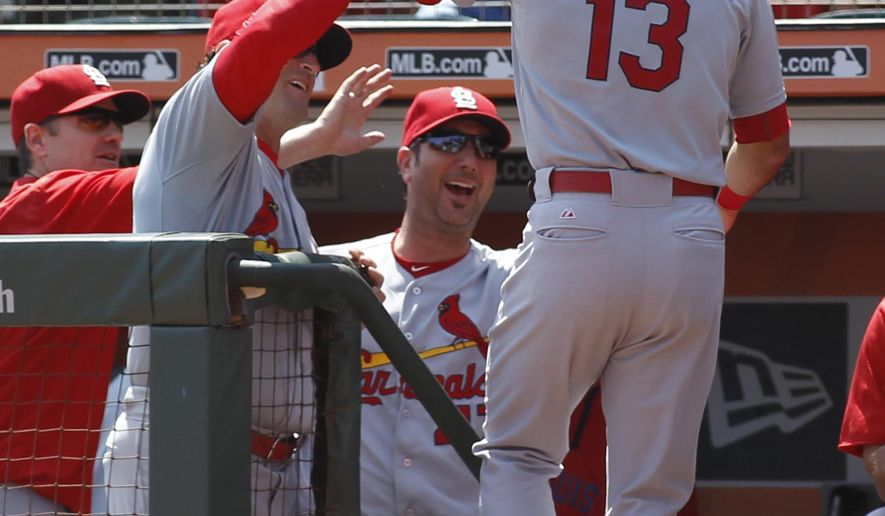 St. Louis Cardinals' Matt Carpenter is greeted in the dugout after hitting a home run against the San Francisco Giants during the first inning of a baseball game, Sunday, Aug. 30, 2015, in San Francisco. (AP Photo/George Nikitin)