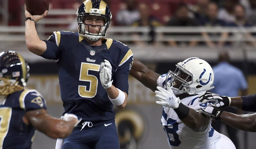 St. Louis Rams quarterback Nick Foles, left, throws under pressure from Indianapolis Colts linebacker Trent Cole during the first quarter of an NFL preseason football game Saturday, Aug. 29, 2015, in St. Louis. (AP Photo/L.G. Patterson)