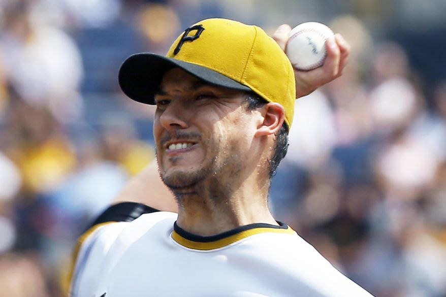 Pittsburgh Pirates starter Charlie Morton pitches against the Colorado Rockies in the first inning of a baseball game, Sunday, Aug. 30, 2015, in Pittsburgh. (AP Photo/Keith Srakocic)