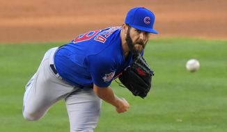 Chicago Cubs starting pitcher Jake Arrieta throws to the plate during the second inning of a baseball game against the Los Angeles Dodgers, Sunday, Aug. 30, 2015, in Los Angeles. (AP Photo/Mark J. Terrill)