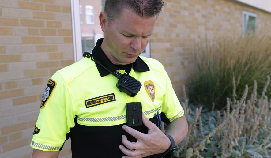 ADVANCE FOR WEEKEND EDITIONS AUG. 29-30 - In this Aug. 13, 2015 photo, Iowa City Police officer David Schwindt displays his body camera in Iowa City, Iowa. Every officer in the Iowa City Police Department is now equipped with a body camera, and police have a new policy governing their use. (David Scrivner/Iowa City Press-Citizen via AP)  NO SALES; MANDATORY CREDIT