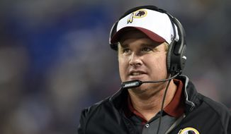 Washington Redskins head coach Jay Gruden stands on the sideline in the second half of a preseason NFL football game against the Baltimore Ravens, Saturday, Aug. 29, 2015, in Baltimore. (AP Photo/Gail Burton)