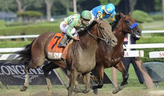 Keen Ice (7), with Javier Castellano, moves past Triple Crown winner American Pharoah, with Victor Espinoza, to win the Travers Stakes horse race at Saratoga Race Course in Saratoga Springs, N.Y., Saturday, Aug. 29, 2015. (AP Photo/Hans Pennink)