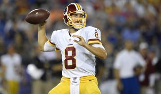 Washington Redskins quarterback Kirk Cousins throws to a receiver in the first half of a preseason NFL football game against the Baltimore Ravens, Saturday, Aug. 29, 2015, in Baltimore. (AP Photo/Nick Wass)