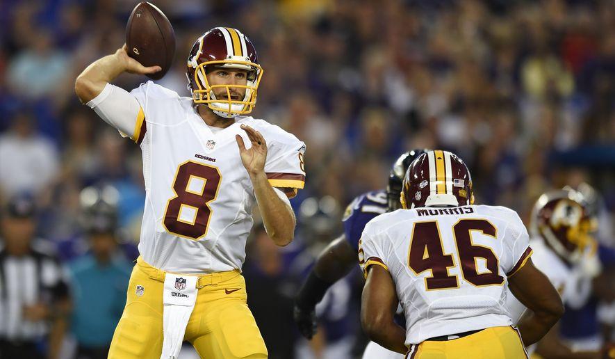 Washington Redskins quarterback Kirk Cousins (8) throws to a receiver in the first half of a preseason NFL football game against the Baltimore Ravens, Saturday, Aug. 29, 2015, in Baltimore. (AP Photo/Gail Burton)