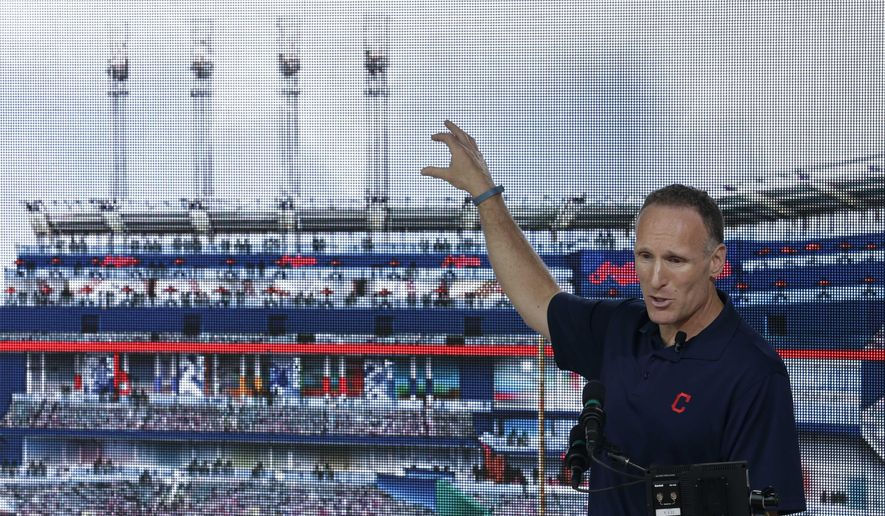 FILE - In this Thursday, Aug. 7, 2014, file photo, Cleveland Indians president Mark Shapiro points out the major renovations to right field at Progressive Field in Cleveland. Shapiro, who has been with Cleveland since 1992, will replace Paul Beeston, the Toronto Blue Jays CEO and president who is retiring. The teams will make the announcement Monday, Aug. 31, 2015, said a person who spoke to The Associated Press on condition of anonymity because the sides were still working through some details. (AP Photo/Tony Dejak, File)