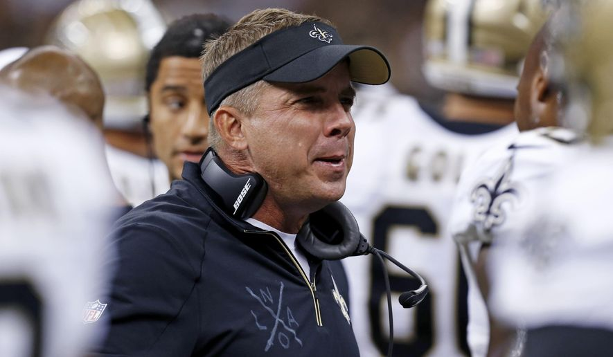 New Orleans Saints head coach Sean Payton talks to players on the sideline in the first half of a preseason NFL football game against the Houston Texans in New Orleans, Sunday, Aug. 30, 2015. (AP Photo/Jonathan Bachman)