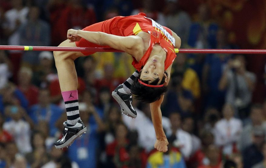 China's Zhang Guowei clears the bar on his way to winning the silver medal in the men's high jump at the World Athletic Championships at the Bird's Nest stadium in Beijing, Sunday, Aug. 30, 2015. (AP Photo/Lee Jin-man)