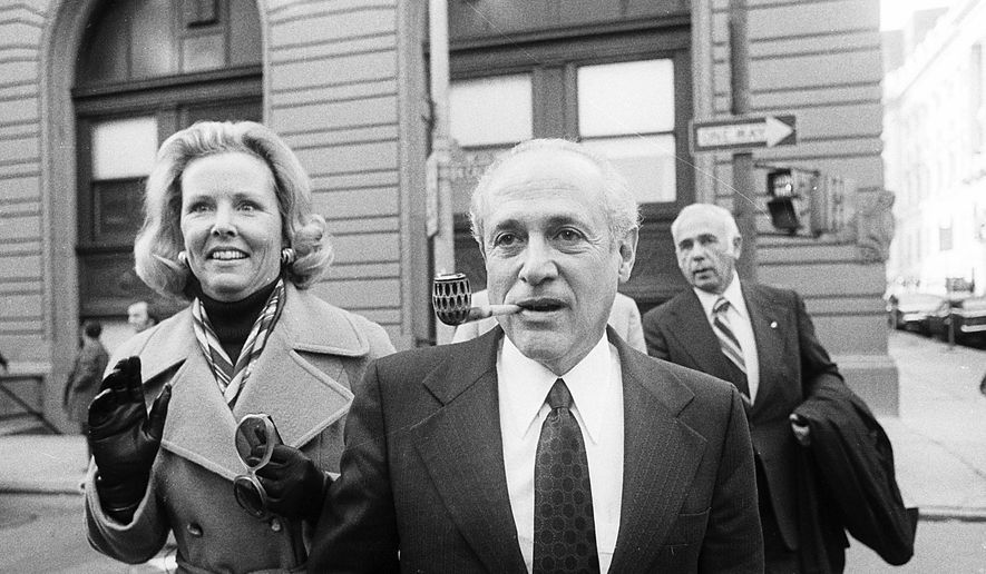 Gov. Marvin Mandel, accompanied by his wife, Jeanne, walking to the federal courthouse in Baltimore in this Oct. 6, 2001, file photo. (AP Photo/Bill Smith) ** FILE **